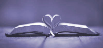 Bible with pages folded in heart shape