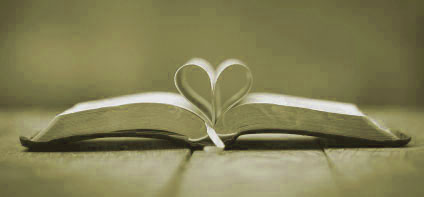 Bible open with pages folded in heart shape